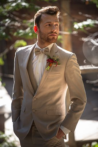 Pine Rose Cabins Wedding Groom wearing a Tan Suit with Red Boutonniere, Pine…