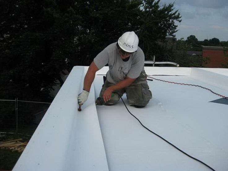 Flat Roof Materials Installation by Handyman