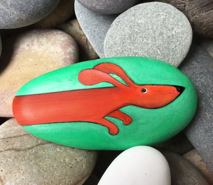 Raw + Design. The Flying Dachshund - painted stone.