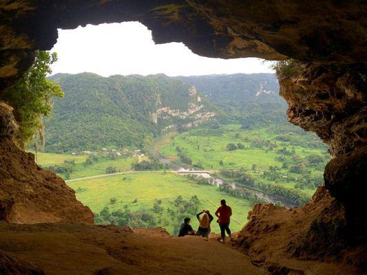 This limestone cave is scenically perched above Puerto Rico's Rio Grande de Arecibo Valley.
