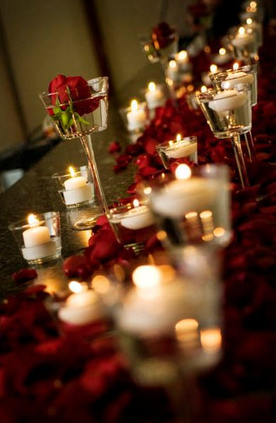 TABLE DECOR or HALL DECOR - Lots of tea light candles lit up. So pretty! And lovely photo!