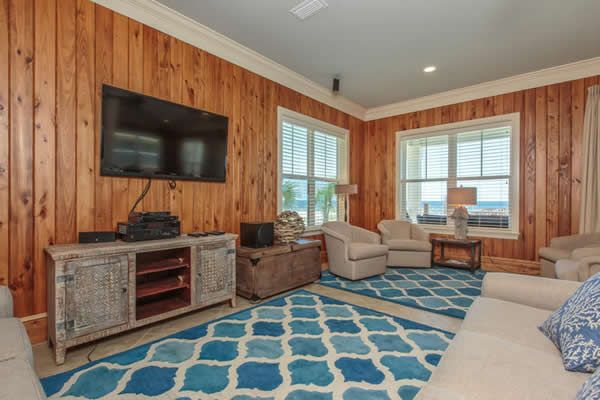 Paint the ceiling, light furniture, fun floor. Pat O'Neal Interiors: knotty pine wall paneling family room