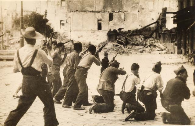 The famous Alcazar in Toledo, where the Nationalists held out for days against Stalin´s Republicanists, was razed to the ground - August 1936. Photo shows Republican militia closing in on Nationalists barricaded in the ruins of the Alcazar in Toledo.""