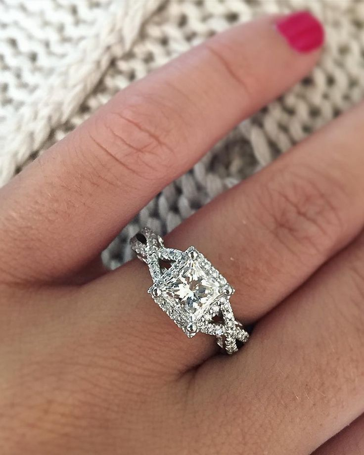 A pretty princess cut halo with a twisted spilt shank  #diamondring #diamonds #engagementrings #trophywife