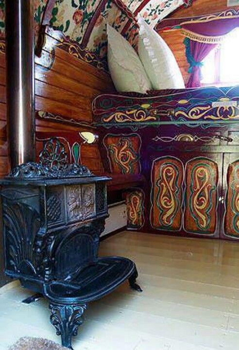 Vardo interior detail pattern paint, wood walls, blues and gold