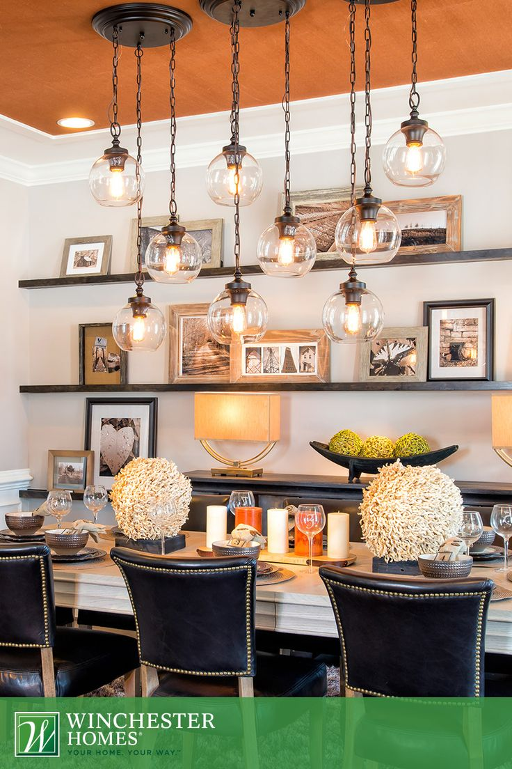 Modern globe lights are paired with recessed lighting in for Dining room globe lighting