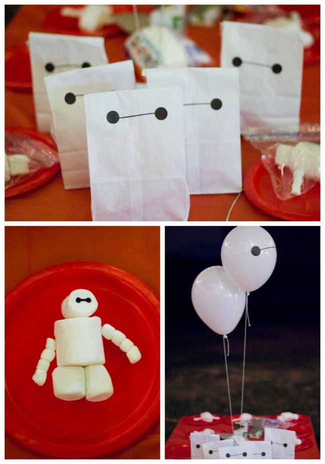 White lunch sack #Baymax party favor bags for Big Hero 6 party. Also add vinyl eye to balloons to make Baymax.