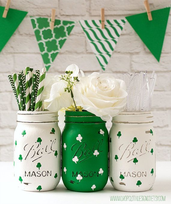 Set of three pint-sized St. Patricks Day mason jars painted and distressed Kelly green and white with hand-painted shamrocks (green on white,
