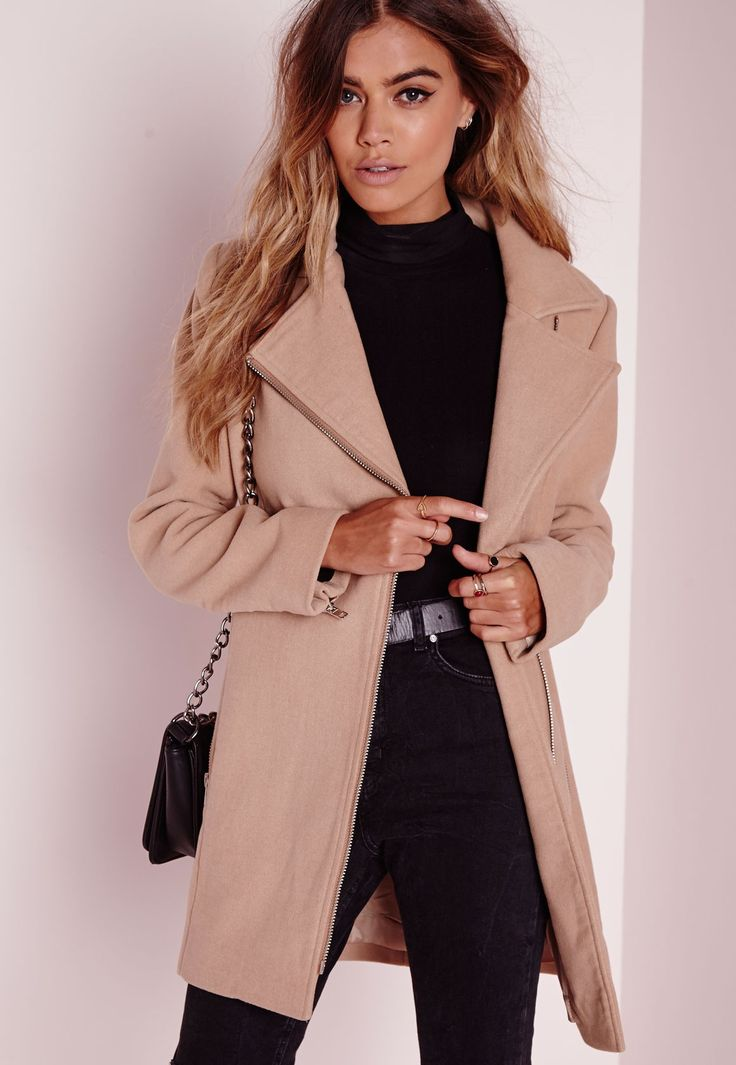 Up your coat game and look totally fierce this season in this camel wool. With on point silver zip asymmetric fastening to the front and exposed biker style zips to the pockets and arms this coat will ensure all eyes are on you. Work this b...