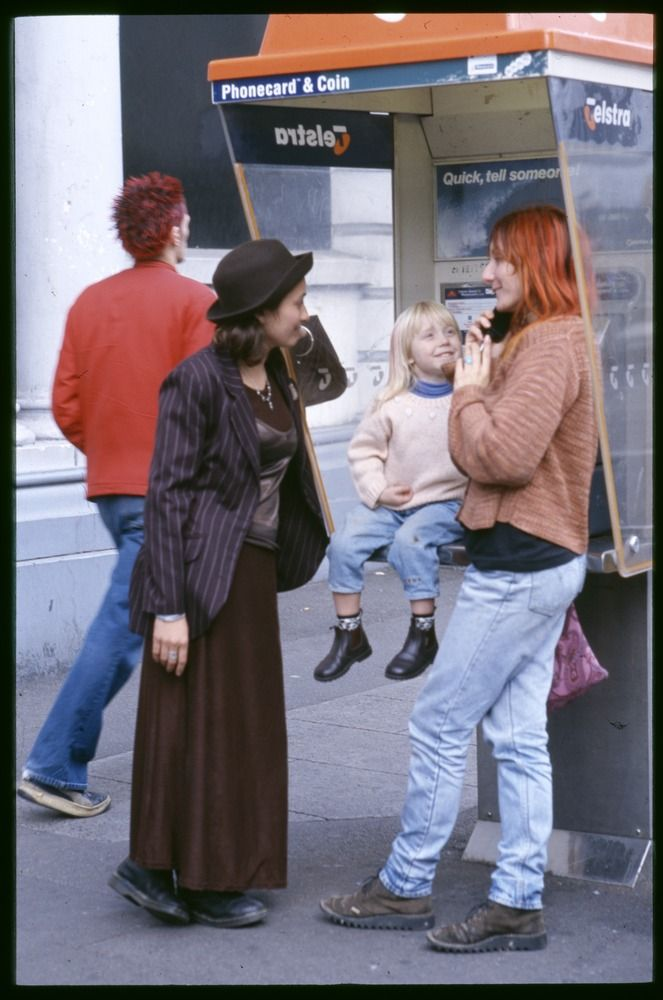 photo Rennie Ellis:  Having a chat, Smith Street, Collingwood, Melbourne Victoria Australia circa  1990s