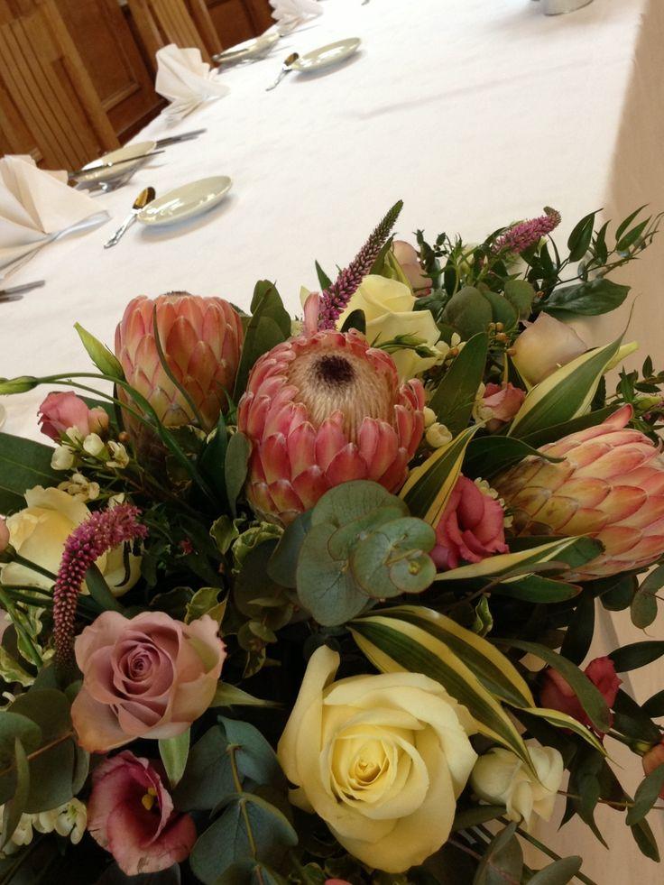 Protea top table long low arrangement by Sarah Lindsey Flowers