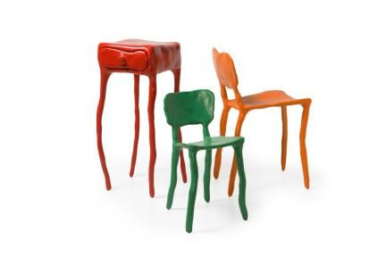"Clay furniture is made of synthetic Clay,  with a metal ""skeleton"" inside to  reinforce the structure. All pieces are  modelled by hand. No moulds are  used in the production, making  each piece unique. The eight standard colors of the  Clay series, are black, white, brown,  red, yellow, blue, orange and green."