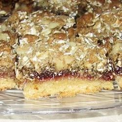 A crust of butter, sugar and flour is layered with raspberry jam, then topped with oats and walnuts.