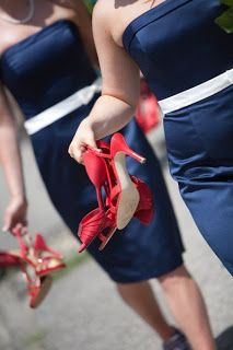 A 4th of July Wedding with bridesmaids in blue tea length dresses, white sashes, and red shoes. Cute!