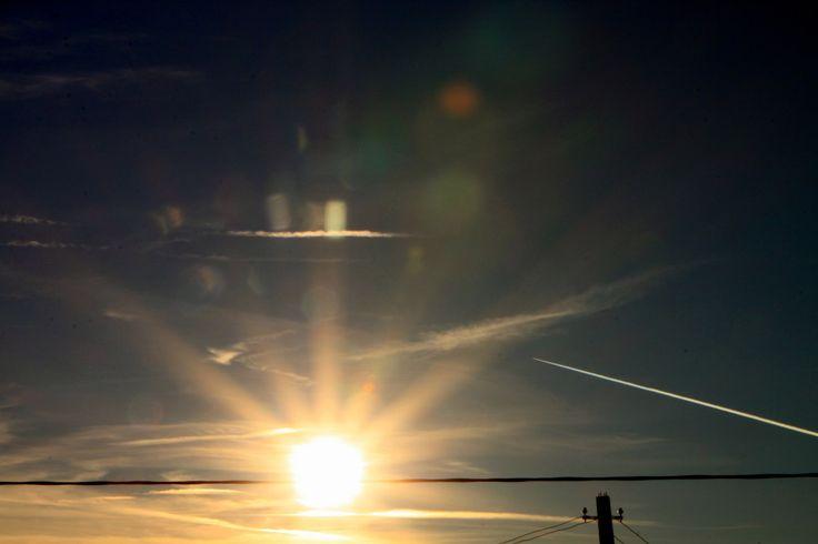 Futuristic Colorful Sky, Airplane Smoke in Bright Sun