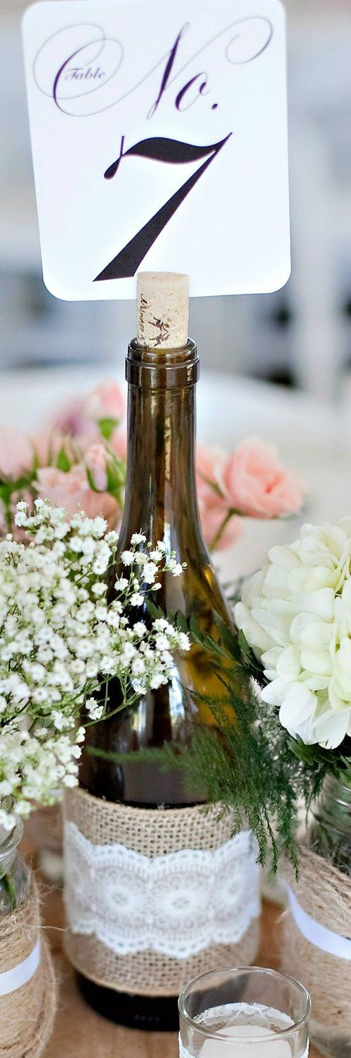 Wie bottles wrapped with burlap and lace.  Used to display table numbers at a wedding reception.  Buyer pays shipping cost.