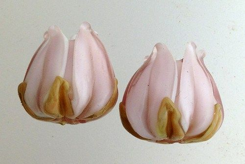 "Adorable pair of tulips in a soft shade of pale amethyst.  Perfect for earrings or bracelets.    Includes: 2 tulip shaped beads approximately 11 mm from hole to hole  Beads were wound on a 3/32"" mandr"