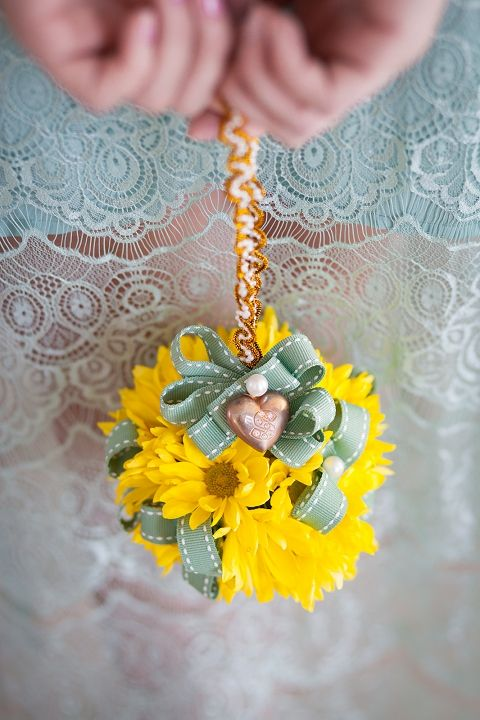styled shoot: yellow & mint inspiration by wedding concepts | bloved weddings | UK Wedding Blog | Wedding Inspiration & Styling yellow daisy pom pom balls so cute to make these with ribbons and flowers to suspend from sides of canopy for appearance day