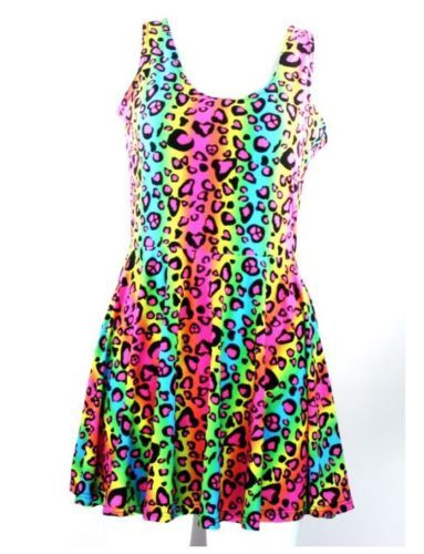 Lisa Frank inspired rainbow animal print dress. Stretchy and Cute. Scoop Neck. Natural Pleats.