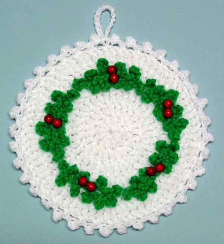 http://www.maggiescrochet.com/pages/holly-wreath-potholder-free-pattern