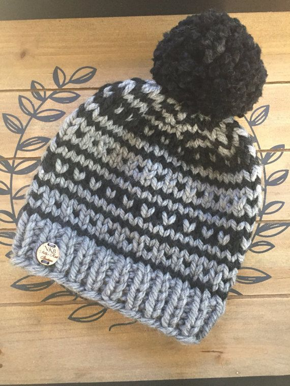 This chic knitted Fair Isle hat accented with a ribbed knit brim is hand crafted…