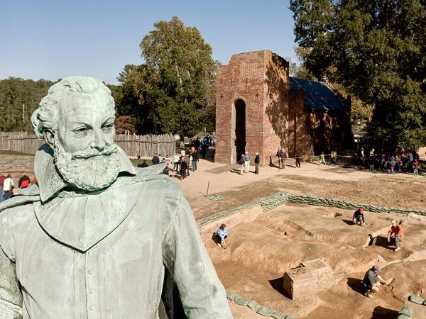 Capt. John Smith statue and Jamestown Memorial Church, showing the excavated site of the original chapel at Jamestown, where Pocahontas married John Rolfe at Jamestown, VA