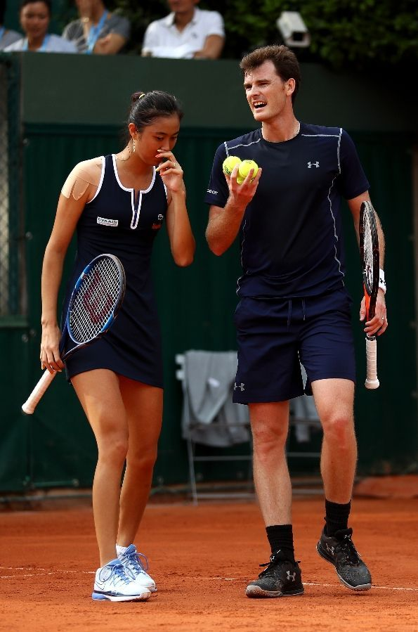 MAY 26: Jamie Murray of Great Britain and Hao-Ching Chan of Taipei talk tactics during the Mixed Doubles first round match against Daria Gavrilova and John Peers of Australia on day five of the 2016 French Open at Roland Garros. (Photo by Julian Finney/Getty Images)