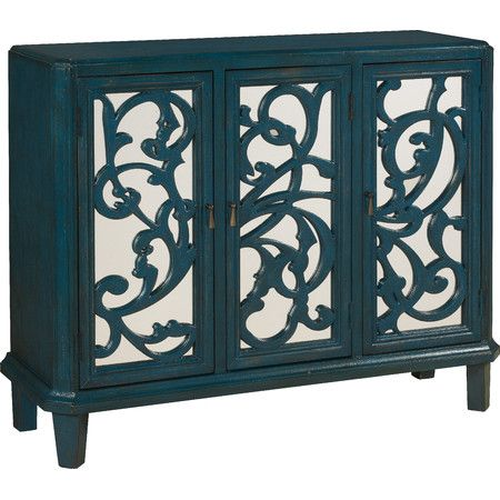 Make a stylish statement in your dining room or den with this rich blue sideboard, showcasing mirror-paneled doors with ornate scrolling overlay.