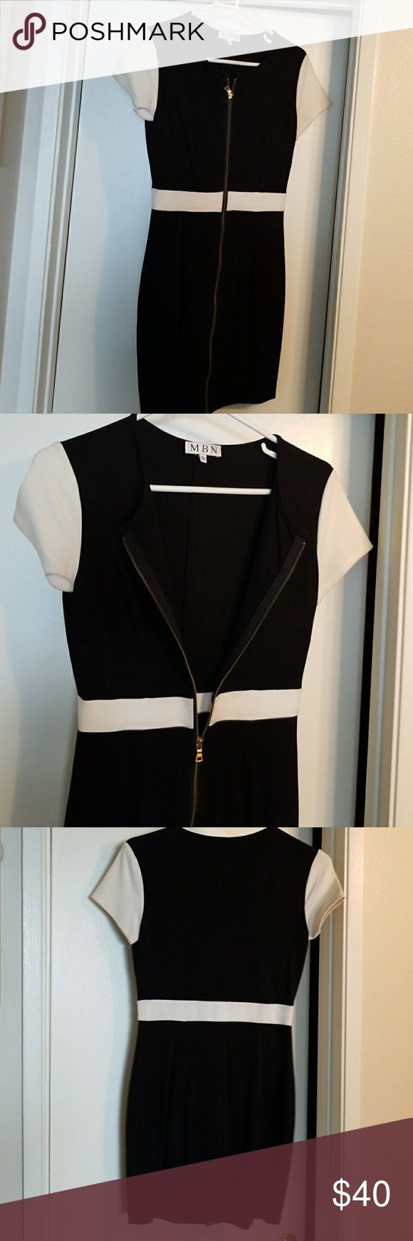 Black and white zip up work dress Zips all the way up and adjust how ever you want. Simple Black and white. Fits like a glove.  Size small. Great for day to night for work and cocktails. MBN Dresses Midi