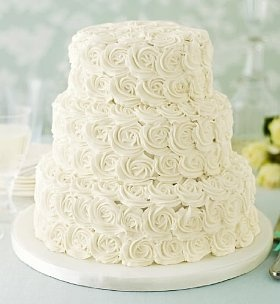 A Three Tier Wedding Cake Hand Decorated With Piped Royal Icing Roses Available In Chocolate