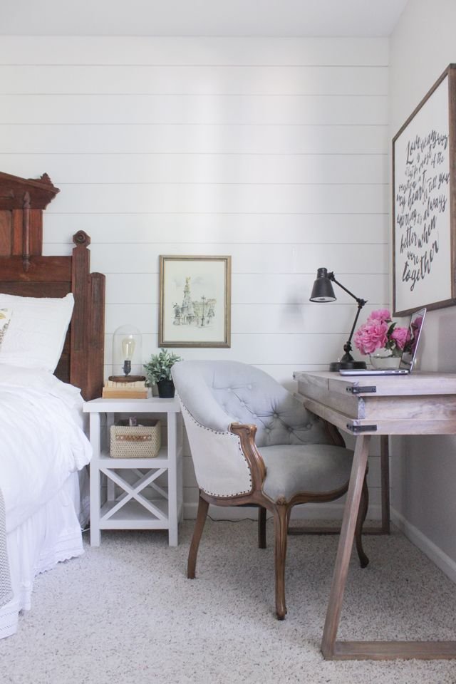 Shiplap wall, DIY small x end table, French chair, and DIY rustic compartment desk in master bedroom.