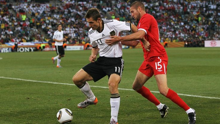 BLOEMFONTEIN, SOUTH AFRICA - JUNE 27: Miroslav Klose of Germany (L) in action against Matthew Upson of England during the 2010 FIFA World Cup South Africa Round of Sixteen match between Germany and England at Free State Stadium on June 27, 2010 in Bloemfontein, South Africa. (Photo by Jamie Squire - FIFA/FIFA via Getty Images)