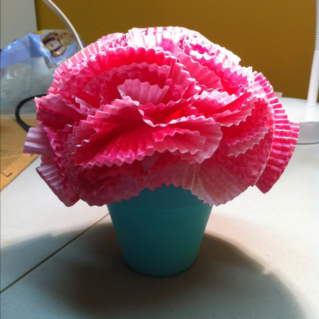 "Centerpiece for cupcake themed birthday party - small flower pot filled with cupcake liner ""flowers"""