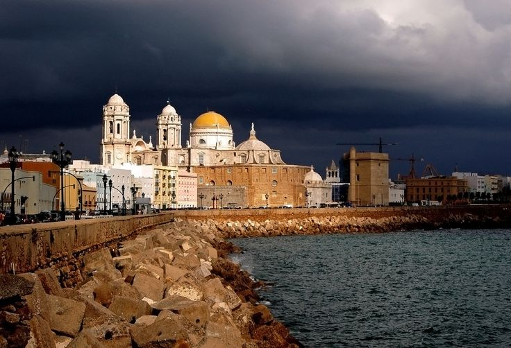 Storm coming over Cadiz Cathedral in the city of Cadiz in Andalusia Spain ( via gornabanja ) Cadiz is said to be one of the oldest cities in Europe, founded by the Phoenicians.