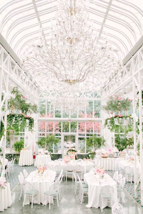 Floor to ceiling windows, chandeliers and rich greenery - perfect for a bridal shower or wedding ~ Conservatory Room, Madison Hotel ~ http://www.stylemepretty.com/2016/05/31/why-flower-bars-are-the-new-it-bridal-shower-detail/