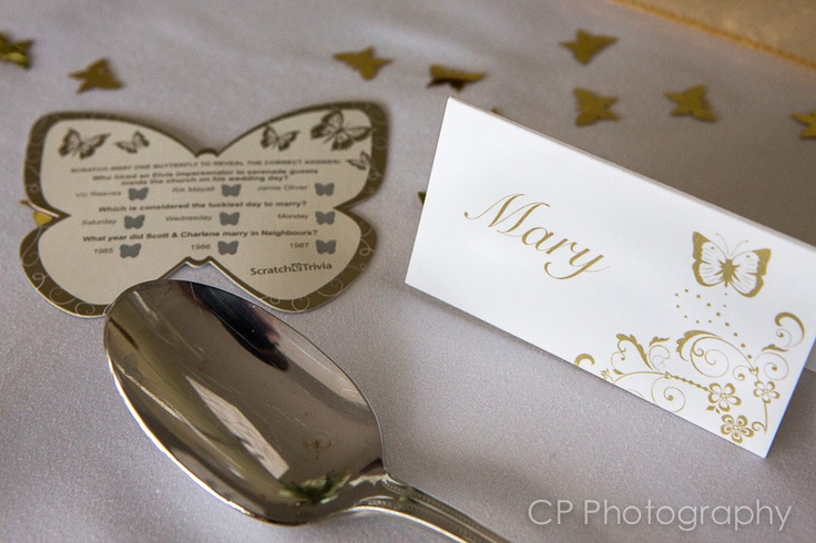 Personalise guests place cards in our gold and ivory butterfly theme.   Matching butterfly trivia cards to get your guests interacting with each other.  These make a great wedding ice breaker.  By www.fuschiadesigns.co.uk.