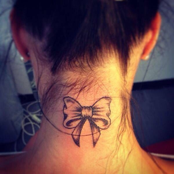 cutest bow tattoo, I love it. perfect place to put it at too<3