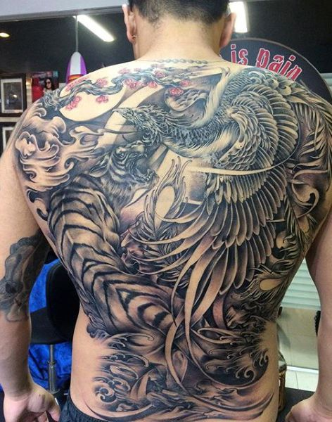 Male With Lovely Large Feathered Pair Of Dragons Tattoo On Full Back