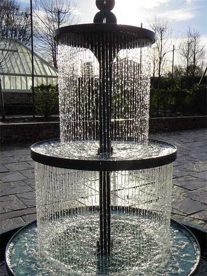 Sun Shining On The Crucello Tiered Fountain At Dusk
