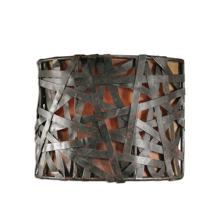 A ornate design, the Trent Austin Design Spiritwind 1 Light Naturals Champagne Wall Sconce will illuminate your room with its warm lighting. The premium quality material used for the fixture construction ensures years of reliable use. The wall sconce is designed with an interwoven fixture and includes a fabric shade. The fixture is available in multiple lustrous finishes and is perfect for bathrooms with rustic settings. The wall sconce requires one incandescent bulb to diffuse light. The…