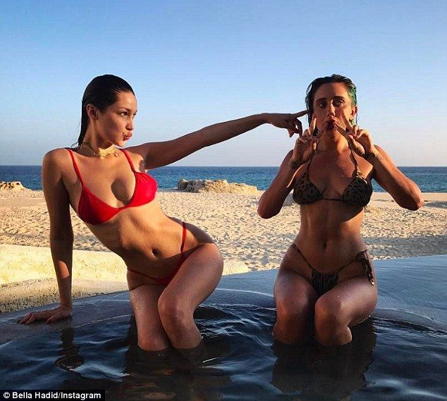 Red hot: Bella Hadid (left) sizzled in a red hot bikini during a girls' weekend in Cabo, Mexico this weekend