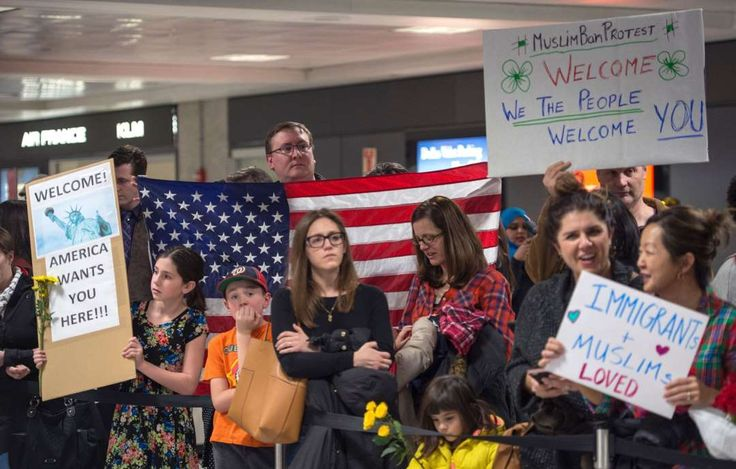 Protests against Trump's immigration ban:     Protesters gather at the international arrivals area of Dulles International Airport, on Jan. 28, 2017, in Sterling, Virginia.