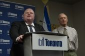 Toronto Mayor Rob Ford addresses the media during a press conference at City Hall on Friday, May 24, 2013. On his right is Deputy Mayor Doug Holyday.