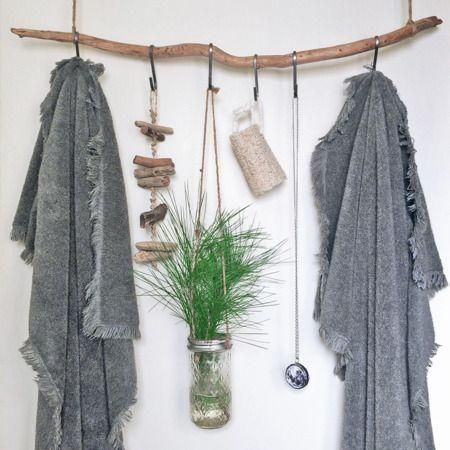 This no-build home decor project let's you hang your bathroom essentials. It's basically a hanging branch shelf with twine S-hooks for your bathroom.