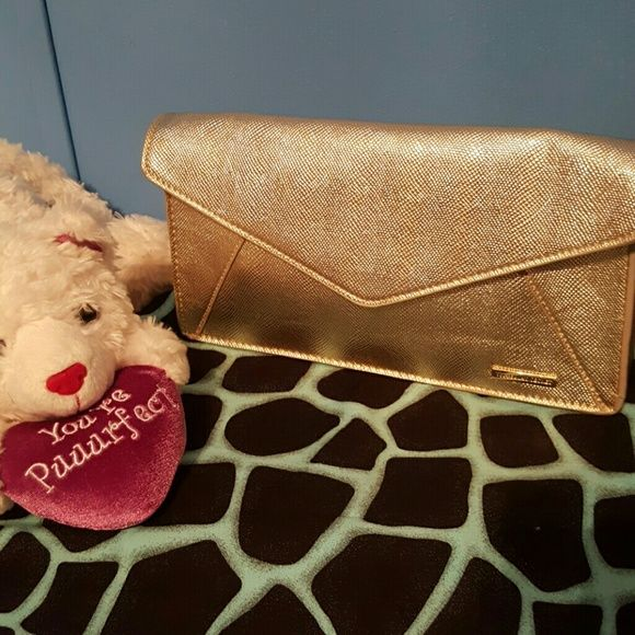 Victoria Secret clutch Gorgeous gold clutch is worthy of prom evening! Very roomy, and an eye turner that doesn't break the bank. Victoria's Secret Bags Clutches & Wristlets