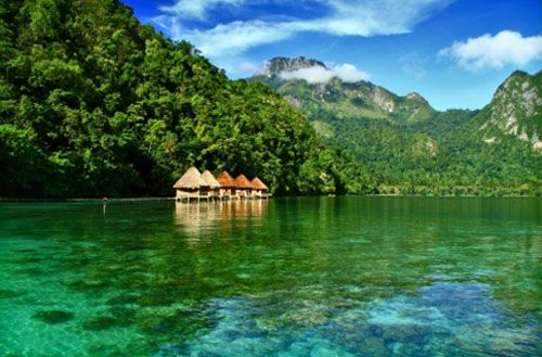 Bungalows floating on top of Ora Beach, Seram Island, Maluku, Indonesia.