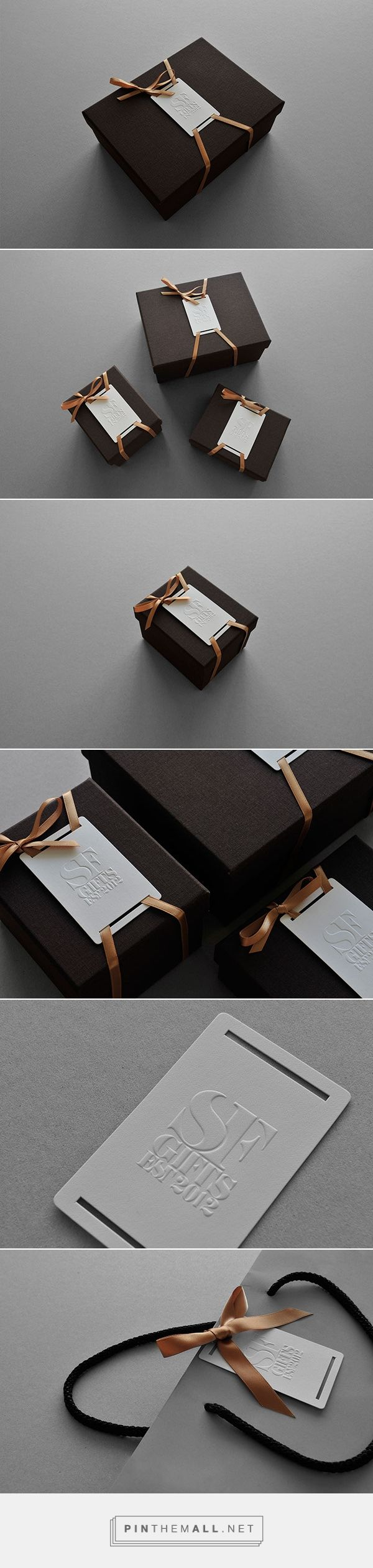 SF Gifts on Behance - contemporary branding and packaging design, white embossed/letterpress logo, dark brown box