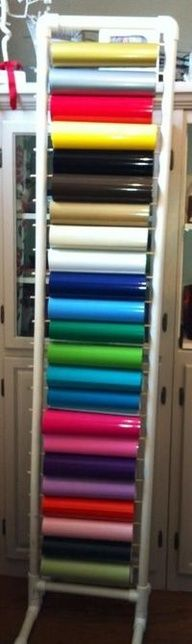 DIY vinyl storage with 1 pvc pipe ... nice! I like this.  What a great idea for storing your vinyl fabric. It takes up little space and can sit right by the cutter to save steps!  Cool!