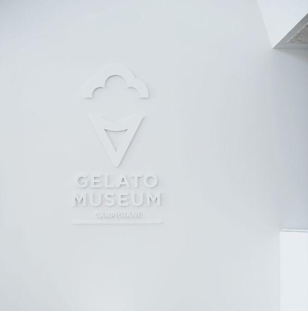 White on white dimensional logo sign | Gelato Museum Carpigiani on Branding Served Served