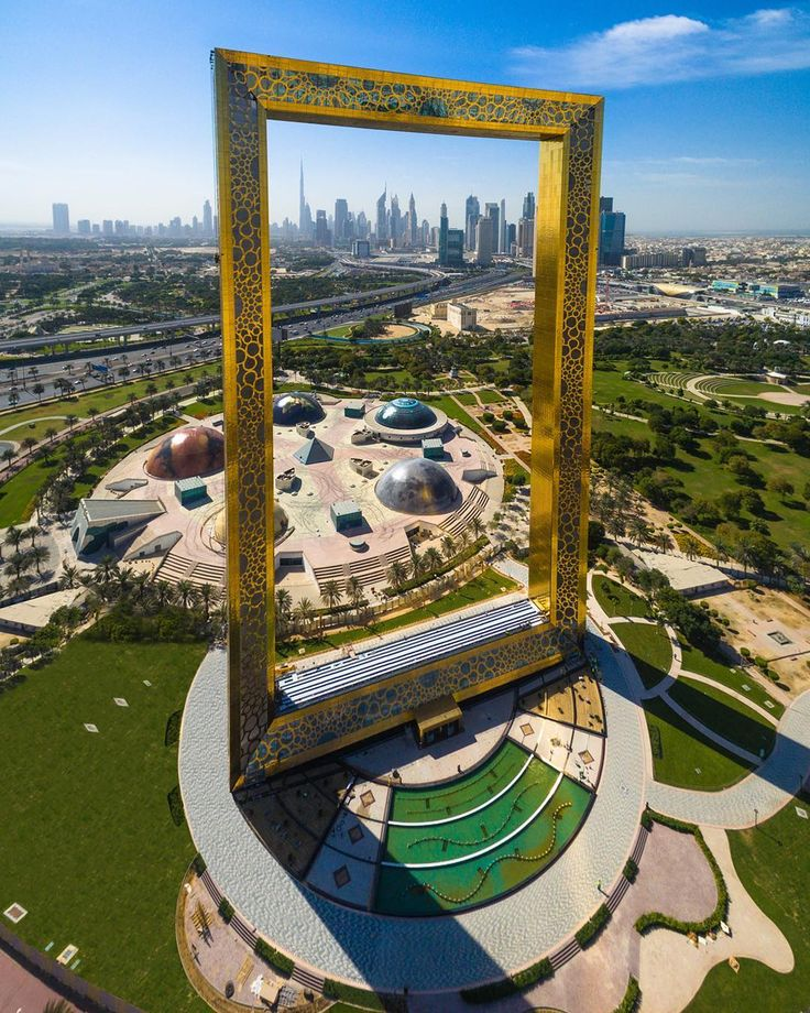 A Giant Interactive Glass and Gold Picture Frame Sculpture That Stands 150 Meters Above Dubai